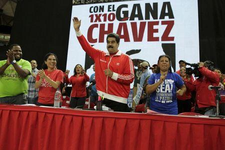 Venezuela's President Nicolas Maduro greets supporters as he arrives to a campaign rally with pro-government candidates for the upcoming parliamentary elections in Caracas