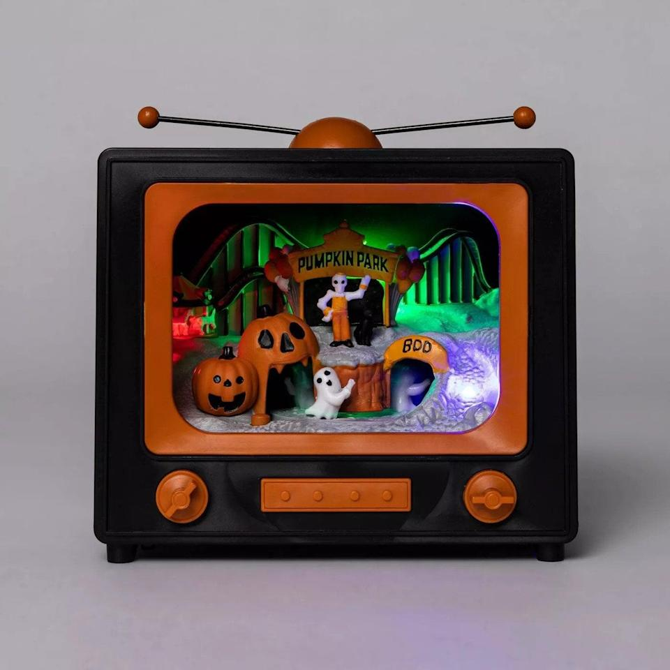 <p>Give your study desk a spooky, vintage twist with this <span>Animated Scene TV Halloween Decorative Prop </span>($15).</p>