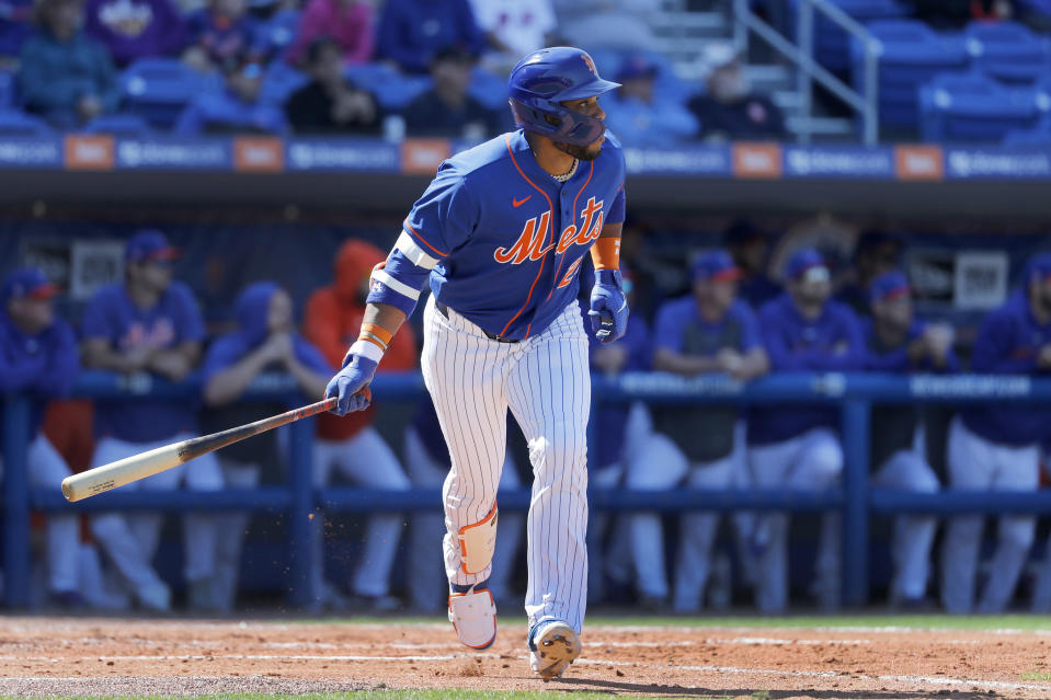 New York Mets' Robinson Cano watches as he flies out during the third inning of a spring training baseball game against the St. Louis Cardinals Friday, Feb. 28, 2020, in Port St. Lucie, Fla. (AP Photo/Jeff Roberson)