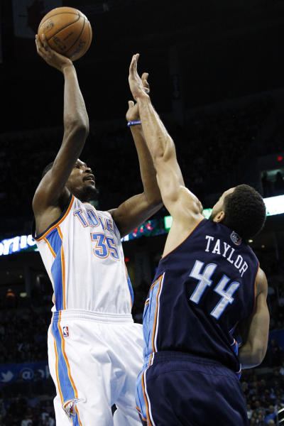 Oklahoma City Thunder forward Kevin Durant (35) shoots as Charlotte Bobcats' Jeff Taylor (44) defends in the second quarter of an NBA basketball game in Oklahoma City, Monday, Nov. 26, 2012. (AP Photo/Sue Ogrocki)
