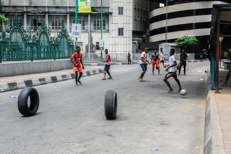 Boys play football in the central business district on the first day of a 14-day lockdown aimed at limiting the spread of coronavirus disease (COVID-19) in Lagos