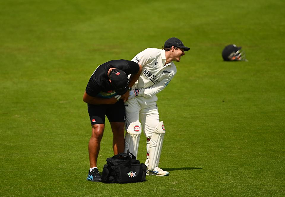 SOUTHAMPTON, ENGLAND - JUNE 23: BJ Watling of New Zealand receives treatment during the Reserve Day of the ICC World Test Championship Final between India and New Zealand at The Hampshire Bowl on June 23, 2021 in Southampton, England. (Photo by Alex Davidson/Getty Images)