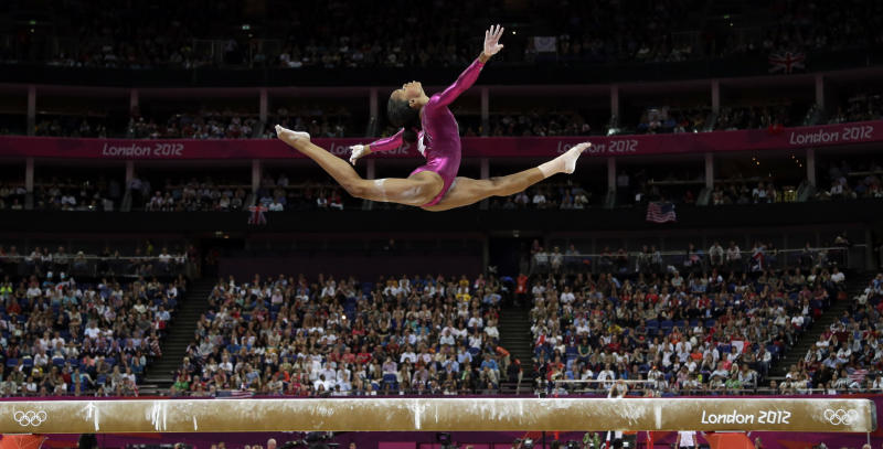 U.S. gymnast Gabrielle Douglas performs on the balance beam during the artistic gymnastics women's individual all-around competition at the 2012 Summer Olympics, Thursday, Aug. 2, 2012, in London. (AP Photo/Gregory Bull)