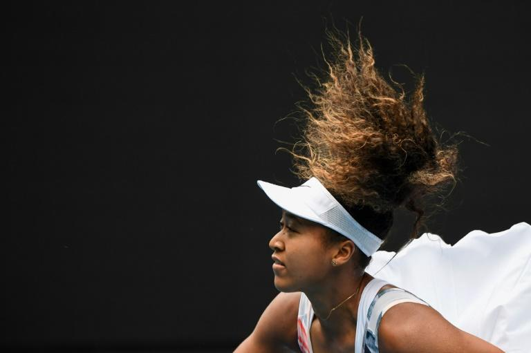 Japan's Naomi Osaka launches serve against Czech Republic's Marie Bouzkova -- one sizzler at 183 kph (114mph) managed to break the net (AFP Photo/William WEST)