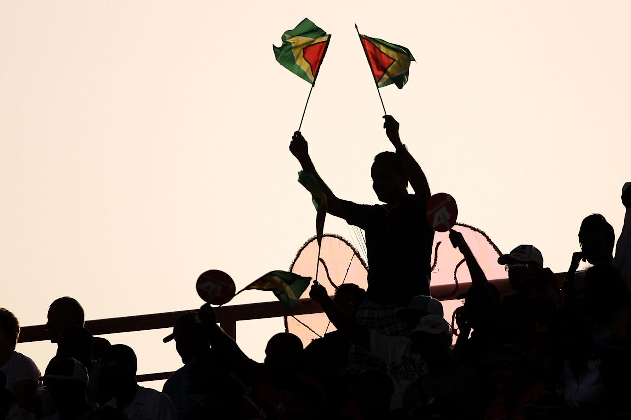PROVIDENCE, GUYANA - APRIL 30:  Fans wave flagsduring the ICC T20 World Cup Group D match between West Indies and Ireland at the Guyana National Stadium Cricket Ground on April 30, 2010 in Providence, Guyana.  (Photo by Clive Rose/Getty Images)
