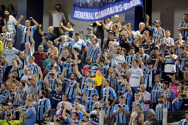 Soccer Football - Paraguay's Cerro Porteno v Brazil's Gremio - Copa Libertadores - General Pablo Rojas Stadium, Asuncion, Paraguay - April 17, 2018. Fans of Gremio cheer for their team. REUTERS/Jorge Adorno