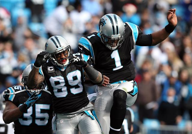 CHARLOTTE, NC - DECEMBER 23: Teammates Steve Smith #89 of the Carolina Panthers and Cam Newton #1 celebrate after a touchdown during their game against the Oakland Raiders at Bank of America Stadium on December 23, 2012 in Charlotte, North Carolina. (Photo by Streeter Lecka/Getty Images)