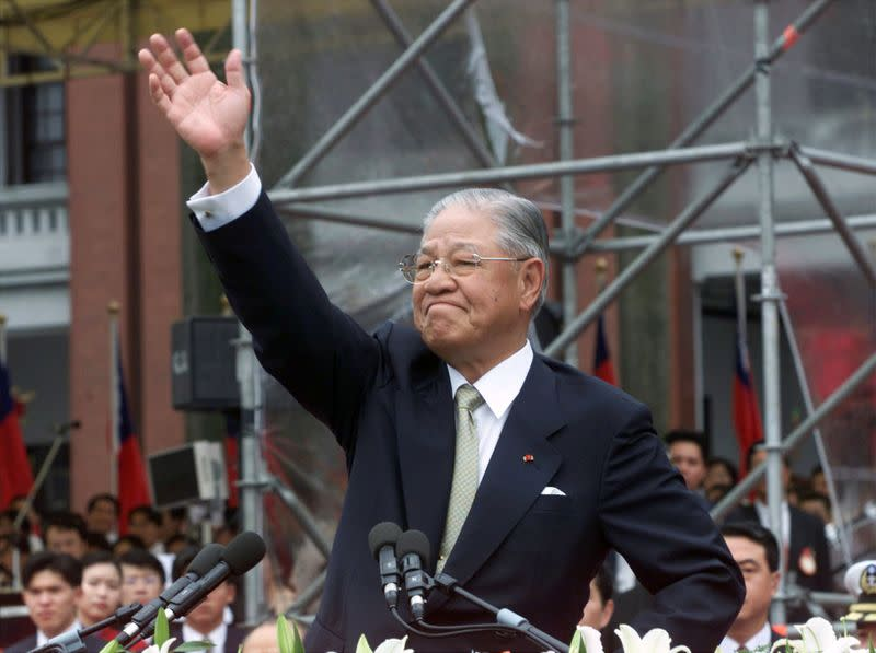 FILE PHOTO: Former Taiwan president Lee Teng-hui waves to the crowd outside the presidential palace in Taipei
