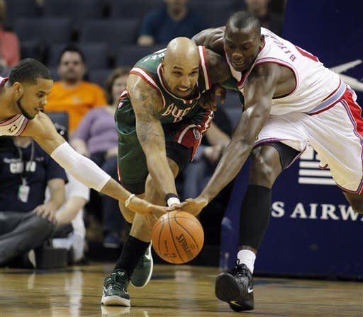 Milwaukee Bucks' Drew Gooden, center, tries to keep control of the ball as Charlotte Bobcats' D.J. Augustin reaches in from the left and Bismack Biyombo reaches in from the right for the steal in the first half of an NBA basketball game in Charlotte, N.C., Friday, March 23, 2012. (AP Photo/Bob Leverone)