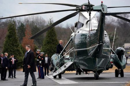 U.S. President Donald Trump boards the Marine One helicopter upon his departure after his annual physical exam at Walter Reed National Military Medical Center in Bethesda,  Maryland, U.S., January 12, 2018. REUTERS/Yuri Gripas