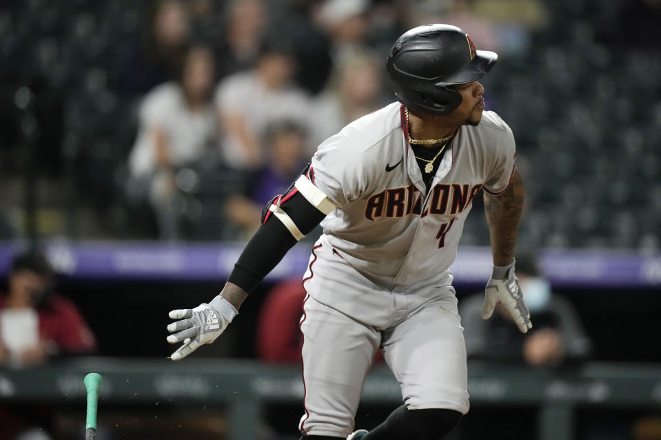 Arizona Diamondbacks' Ketel Marte grounds out against Colorado Rockies relief pitcher Yency Almonte to end the ninth inning of a baseball game Friday, May 21, 2021, in Denver. (AP Photo/David Zalubowski)