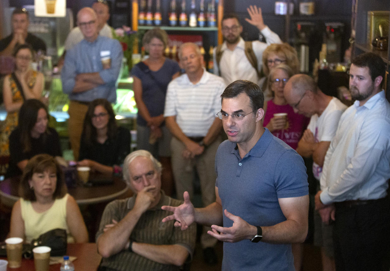 Rep. Justin Amash, I-Mich., speaks with constituents at Common Ground, a coffee shop in Grand Rapids. (Photo: Evan Cobb for the Washington Post via Getty Images)