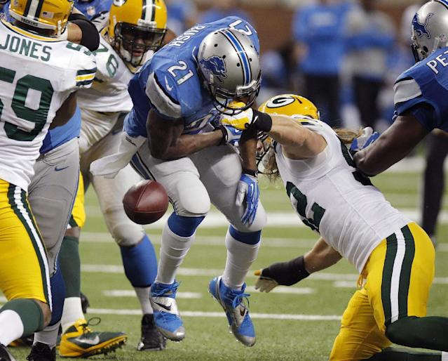 Detroit Lions running back Reggie Bush (21) fumbles during the first quarter of an NFL football game against the Green Bay Packers at Ford Field in Detroit, Thursday, Nov. 28, 2013. (AP Photo/Duane Burleson)