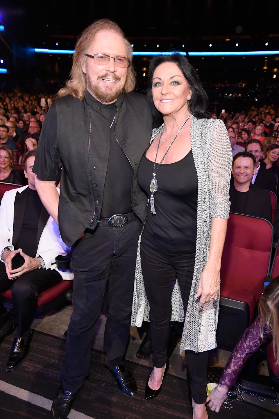 """LOS ANGELES, CA - FEBRUARY 14: Singer Barry Gibb (L) and Linda Gray attend """"Stayin' Alive: A GRAMMY Salute To The Music Of The Bee Gees"""" on February 14, 2017 in Los Angeles, California. (Photo by Kevin Mazur/WireImage)"""