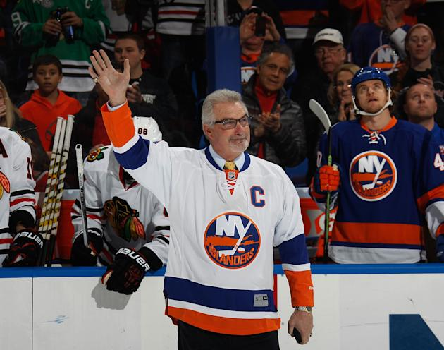 UNIONDALE, NY - DECEMBER 13: Former New York Islander Clark Gillies is honored prior to the game against the Chicago Blackhawks aat the Nassau Veterans Memorial Coliseum on December 13, 2014 in Uniondale, New York. (Photo by Bruce Bennett/Getty Images)