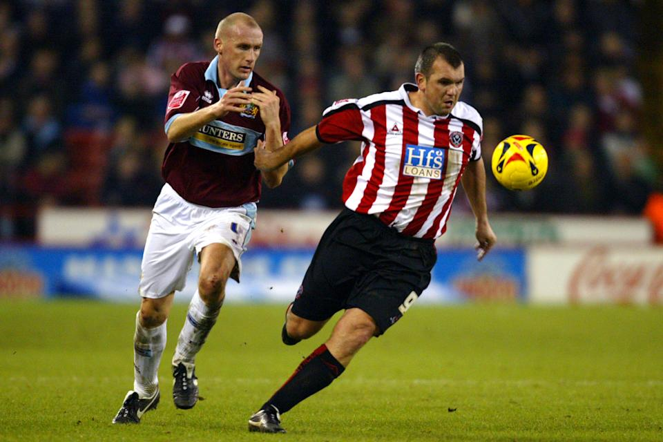 Sheffield United's Neil Shipperley (r) holds off Burnley's John McGreal  (Photo by Barrington Coombs - PA Images via Getty Images)