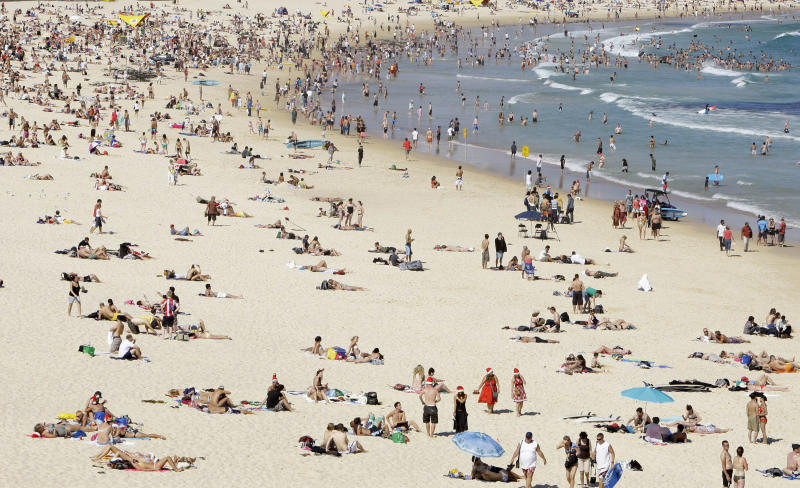 In this Dec. 25, 2008 file photo, people gather on Bondi Beach in Sydney, Australia. Bondi is the best-known Sydney beach, attracting surfers, sunbathers and more than a few local eccentrics (people-watching here is highly entertaining). (AP Photo/Rick Rycroft)
