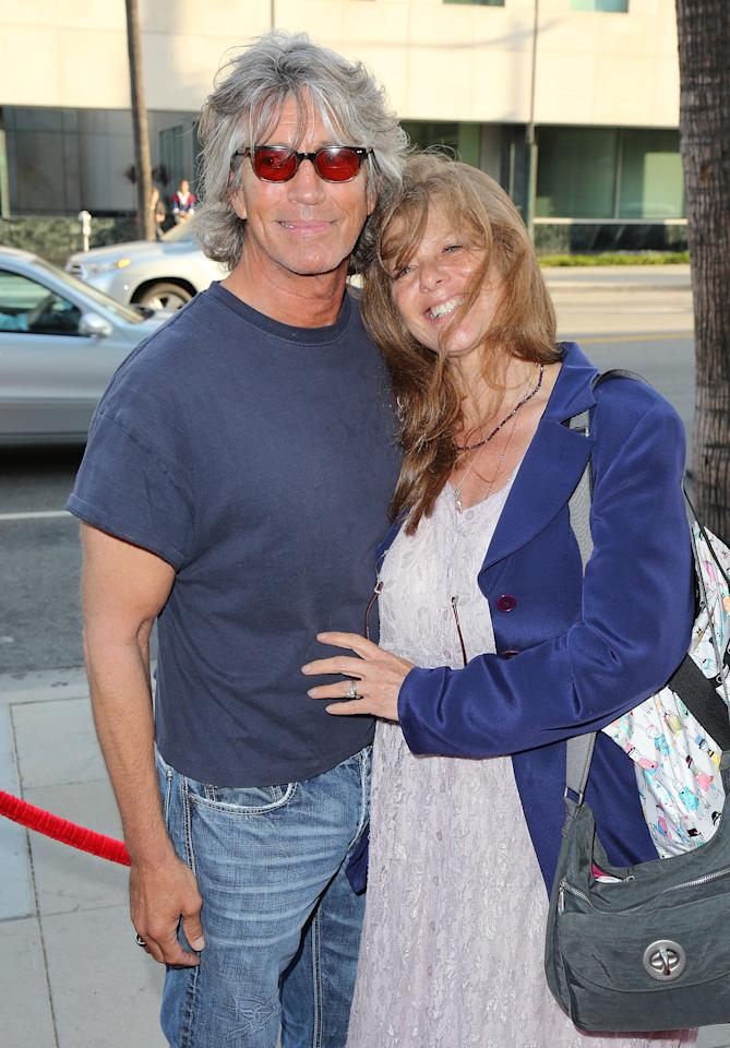 """BEVERLY HILLS, CA - JULY 24:  Actor Eric Roberts (L) and wife Eliza Roberts attend the premiere of """"Blue Jasmine"""" hosted by the AFI & Sony Picture Classics at the AMPAS Samuel Goldwyn Theater on July 24, 2013 in Beverly Hills, California.  (Photo by David Livingston/Getty Images)"""