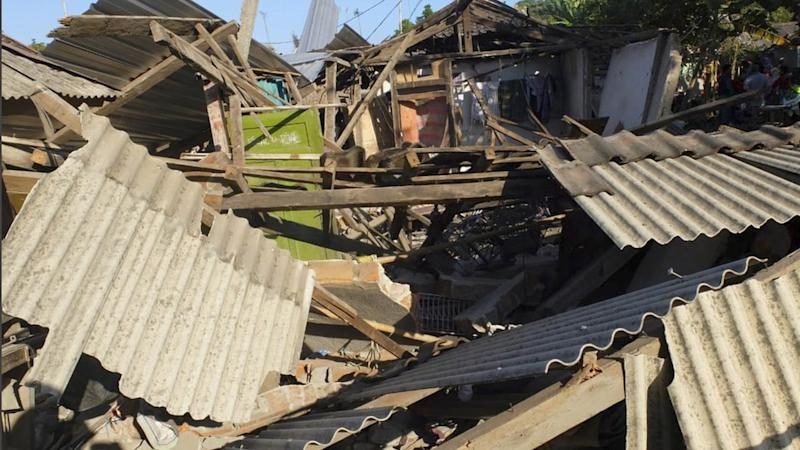 A powerful 7.0 quake has caused massive damage on Lombok Island claiming at least 91 lives