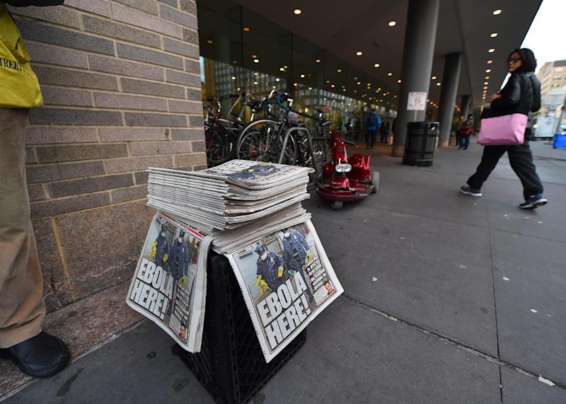 A newspaper vendor sells copies of the New York Post in front of the entrance to Bellevue Hospital October 24, 2014 in New York (AFP Photo/Timothy A. Clary)