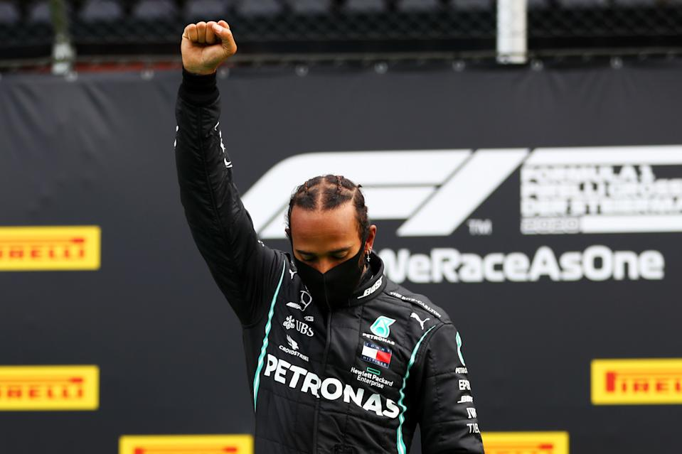 Lewis Hamilton raised his fist in the Black power salute after winning the Styrian Grand Prix. (Photo by Dan Istitene - Formula 1/Formula 1 via Getty Images)