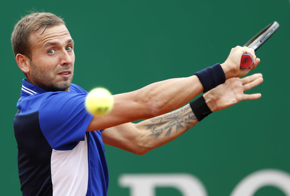 Daniel Evans of Britain returns the ball to Stefanos Tsitsipas of Greece during their semifinal match of the Monte Carlo Tennis Masters tournament in Monaco, Saturday, April 17, 2021. (AP Photo/Jean-Francois Badias)