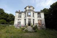 The 19th century manor is a shadow of its former self. Families steadily began to leave once the airport opened, now only a few remain in the historic village. (Reuters)