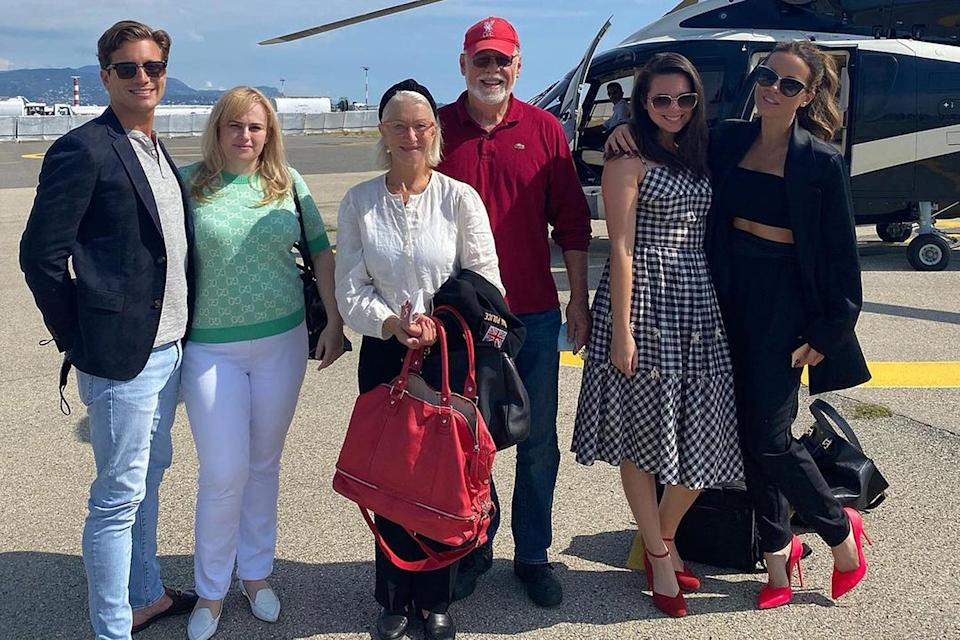 """<p>The couple first went public on Instagram on Sept. 24, 2020, when Wilson shared a group shot of the pair boarding a helicopter to Monaco alongside <a href=""""https://people.com/tag/helen-mirren"""" rel=""""nofollow noopener"""" target=""""_blank"""" data-ylk=""""slk:Helen Mirren"""" class=""""link rapid-noclick-resp"""">Helen Mirren</a> and <a href=""""https://people.com/tag/kate-beckinsale"""" rel=""""nofollow noopener"""" target=""""_blank"""" data-ylk=""""slk:Kate Beckinsale"""" class=""""link rapid-noclick-resp"""">Kate Beckinsale</a>. </p> <p><a href=""""https://people.com/movies/rebel-wilson-steps-out-with-new-boyfriend-jacob-busch/"""" rel=""""nofollow noopener"""" target=""""_blank"""" data-ylk=""""slk:Busch is part of the Busch family"""" class=""""link rapid-noclick-resp"""">Busch is part of the Busch family</a>, founders of the Anheuser-Busch brewing dynasty. He launched his own brewery in 2016, Son's Beer, alongside his friends Elliott Taylor and Carlo Mondavi.</p>"""
