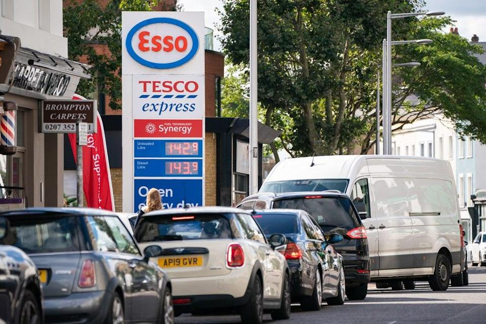 Vehicles queue for fuel at a petrol station in west London (PA)