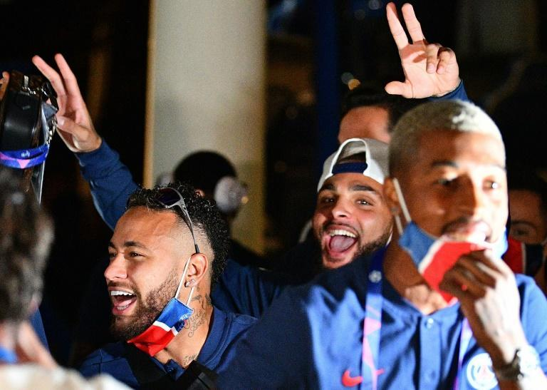 Paris Saint-Germain players, including Neymar, celebrate at the team's hotel in Lisbon after winning through to the Champions League final
