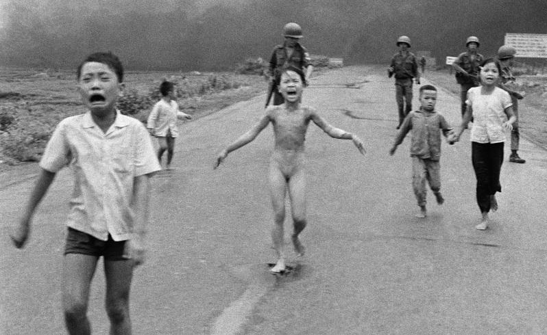In this June 8, 1972 file photo, crying children, including 9-year-old Kim Phuc, center, run down Route 1 near Trang Bang, Vietnam after an aerial napalm attack on suspected Viet Cong hiding places as South Vietnamese forces from the 25th Division walk behind them. A South Vietnamese plane accidentally dropped its flaming napalm on South Vietnamese troops and civilians. From left, the children are Phan Thanh Tam, younger brother of Kim Phuc, who lost an eye, Phan Thanh Phouc, youngest brother of Kim Phuc, Kim Phuc, and Kim's cousins Ho Van Bon, and Ho Thi Ting. Picture: Nick Ut