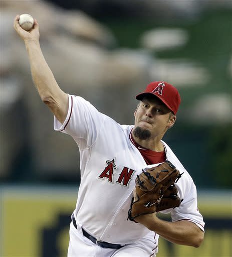 Los Angeles Angels starter Joe Blanton pitches to the Houston Astros in the first inning of a baseball game in Anaheim, Calif., Monday, June 3, 2013. (AP Photo/Reed Saxon)