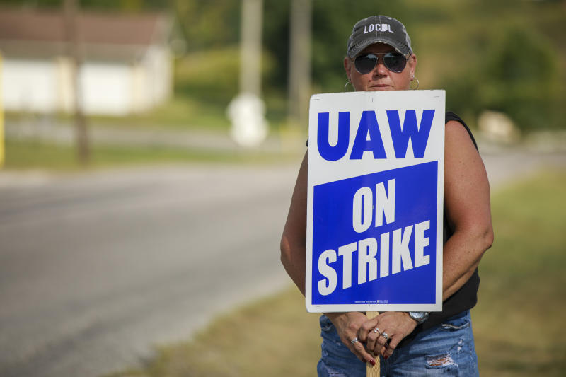 BEDFORD, INDIANA, UNITED STATES - 2019/09/16: A General Motors worker holds a picket sign after United Auto Workers Local 440 workers joined a national labor strike against GM. The strike involving over 49,000 workers nationwide began at midnight. Over 700 work at the Bedford plant. The United Auto Worker union is leading it's first nationwide strike against General Motors (GM) since 1982, seeking to fight for jobs and more benefits which will cost the company dearly for an indefinite period of time. (Photo by Jeremy Hogan/SOPA Images/LightRocket via Getty Images)