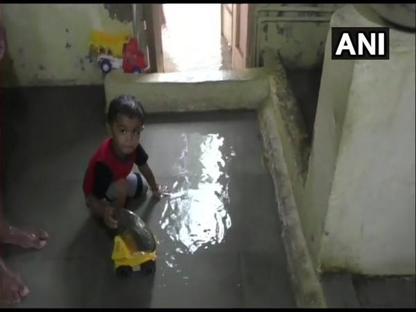 Rainwater enters houses in several areas of Mehsana following heavy rainfall in Gujarat (Photo/ANI)