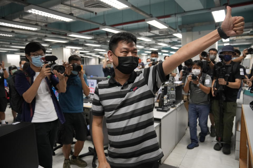 Lam Man-chung, Executive Editor-in-Chief of Apple Daily gesture at the headquarters in Hong Kong, Wednesday, June 23, 2021. Hong Kong's pro-democracy Apple Daily newspaper will stop publishing Thursday, following last week's arrest of five editors and executives and the freezing of $2.3 million in assets under the city's one-year-old national security law. (AP Photo/Kin Cheung)