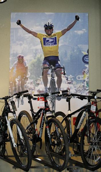 A poster of Lance Armstrong adorns a wall at a bike shop in Austin, Texas, on October 18, 2012 (AFP Photo/Aaron M. Sprecher)
