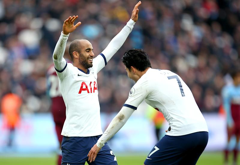 Tottenham Hotspur's Lucas Moura (left) celebrates scoring his side's second goal of the game with team mate Son Heung-min West Ham United v Tottenham Hotspur - Premier League - London Stadium 23-11-2019 . (Photo by Steven Paston/EMPICS/PA Images via Getty Images)