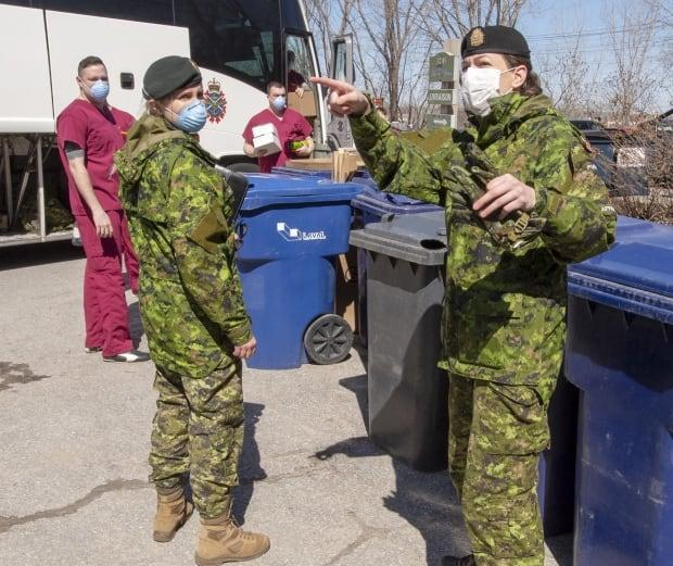 Canadian Armed Forces personnel arrive at the Villa Val des Arbes seniors residence in Laval, Que., on April 20, 2020.