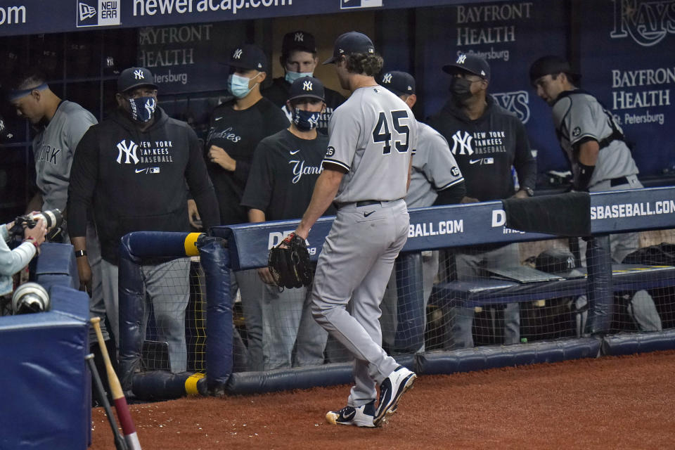 New York Yankees starting pitcher Gerrit Cole (45) walks off the field after retiring the Tampa Bay Rays during the eighth inning of a baseball game Wednesday, May 12, 2021, in St. Petersburg, Fla. (AP Photo/Chris O'Meara)