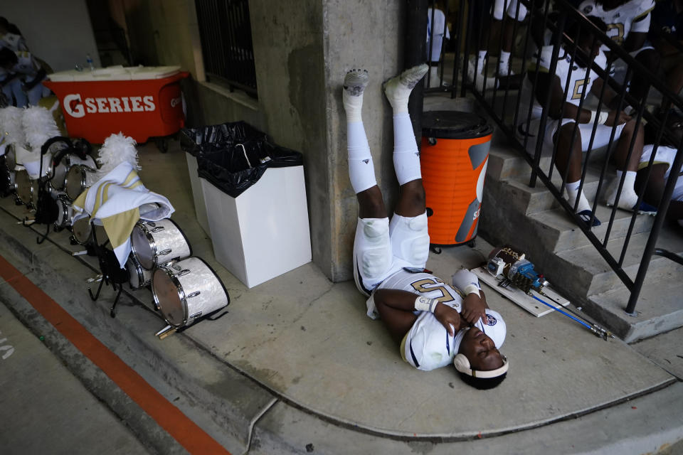 Georgia Tech defensive lineman Jared Ivey (15) waits out a lightning delay that halted play in the first half of an NCAA college football game against Clemson, Saturday, Sept. 18, 2021, in Clemson, S.C. (AP Photo/John Bazemore)
