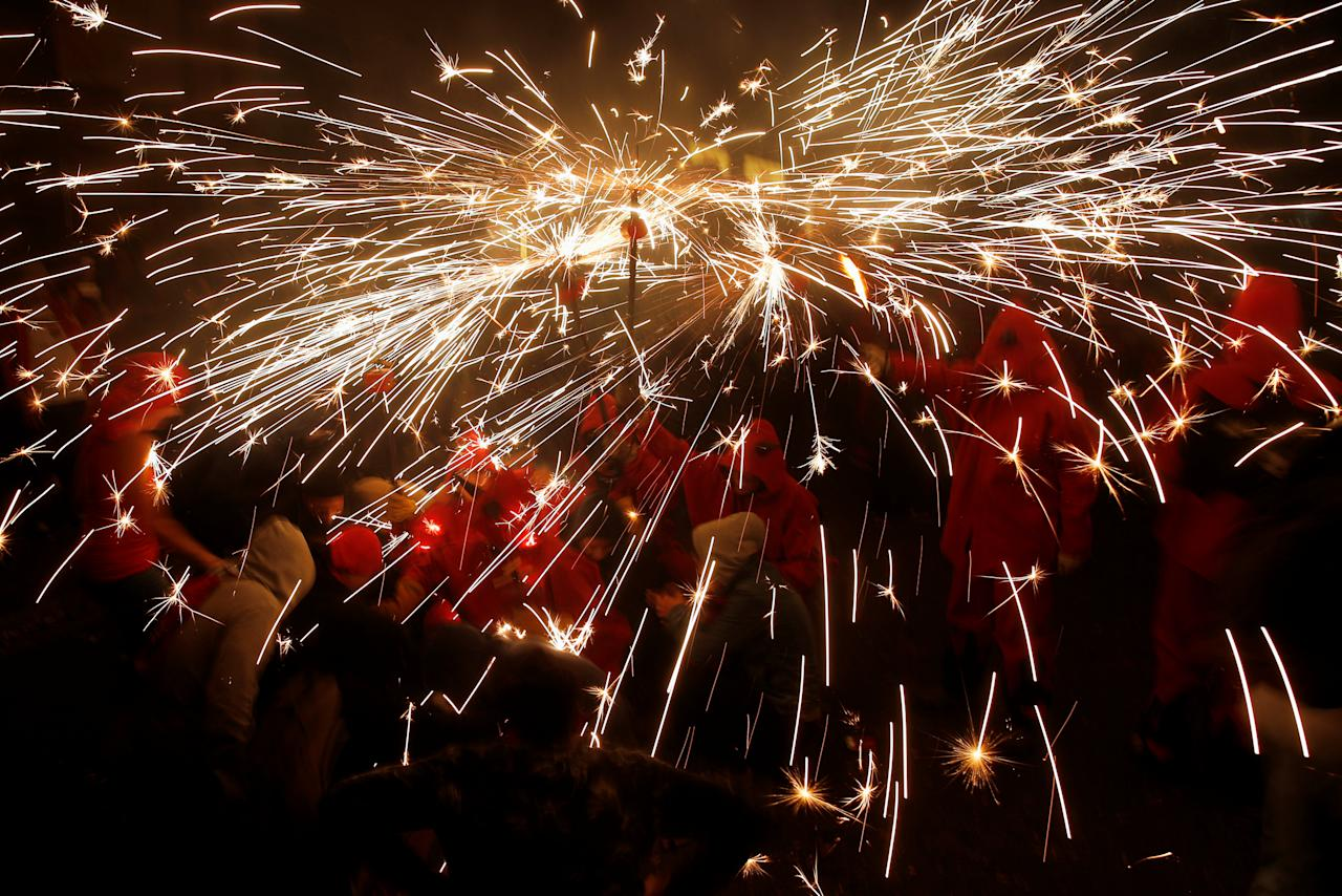 "Revellers dressed as demons celebrate with fireworks through the streets during the festival of the patron saint of Barcelona ""The Virgin of Mercy"" in Barcelona, Spain, September 23, 2017. REUTERS/Jon Nazca"