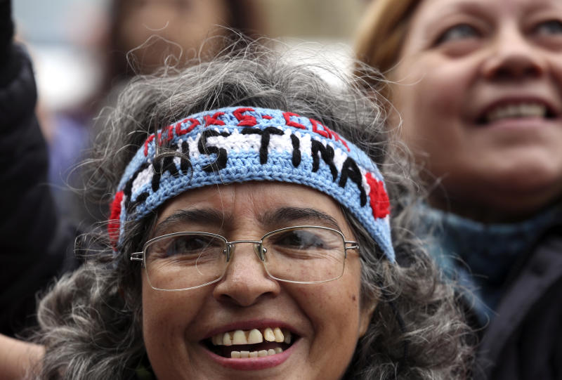 Supporters of former President Cristina Fernandez gather outside a federal court as Fernandez appears for the first in a series of corruption trials, in Buenos Aires, Argentina, Tuesday, May 21, 2019. (AP Photo/Marcos Brindicci)