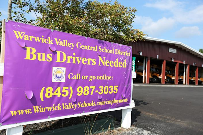 """A sign for """"Bus Drivers Needed"""" outside the bus garage for the Warwick Valley Central School District in New York on Sept. 8."""