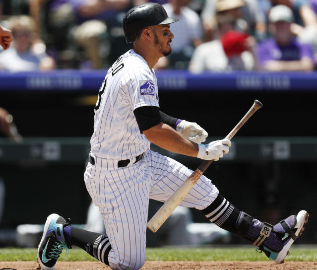 Colorado Rockies' Nolan Arenado reacts after striking out against Miami Marlins starting pitcher Trevor Richards to end the first inning of a baseball game Saturday, June 23, 2018, in Denver. (AP Photo/David Zalubowski)