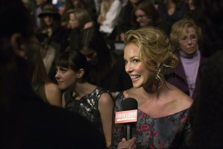 Actress Katherine Heigl is interviewed in the front row at the J. Mendel Autumn/Winter 2013 collection during New York Fashion Week