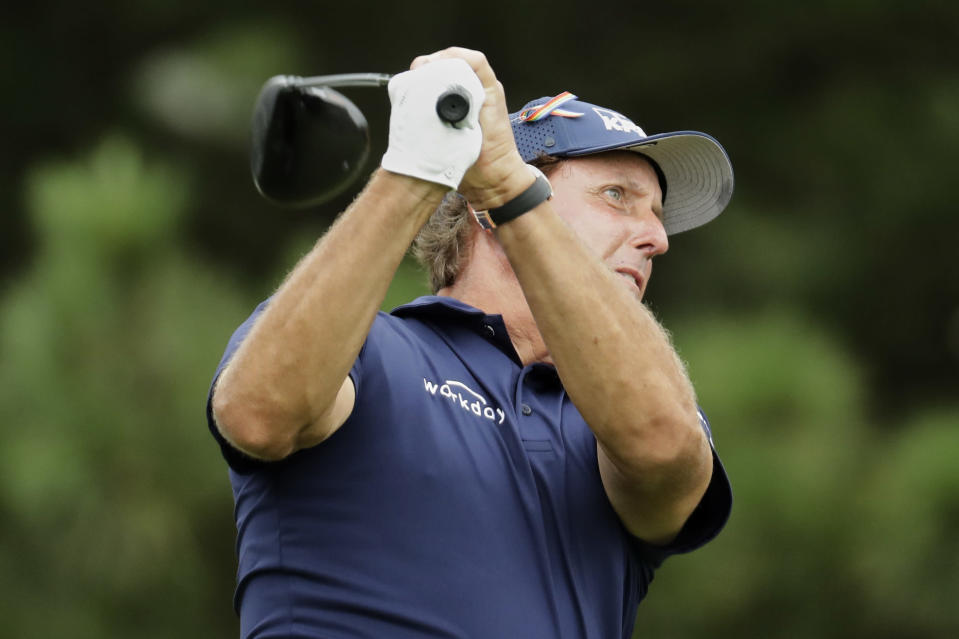Phil Mickelson watches his tee shot on the 17th hole during the third round of the World Golf Championship-FedEx St. Jude Invitational Saturday, Aug. 1, 2020, in Memphis, Tenn. (AP Photo/Mark Humphrey)