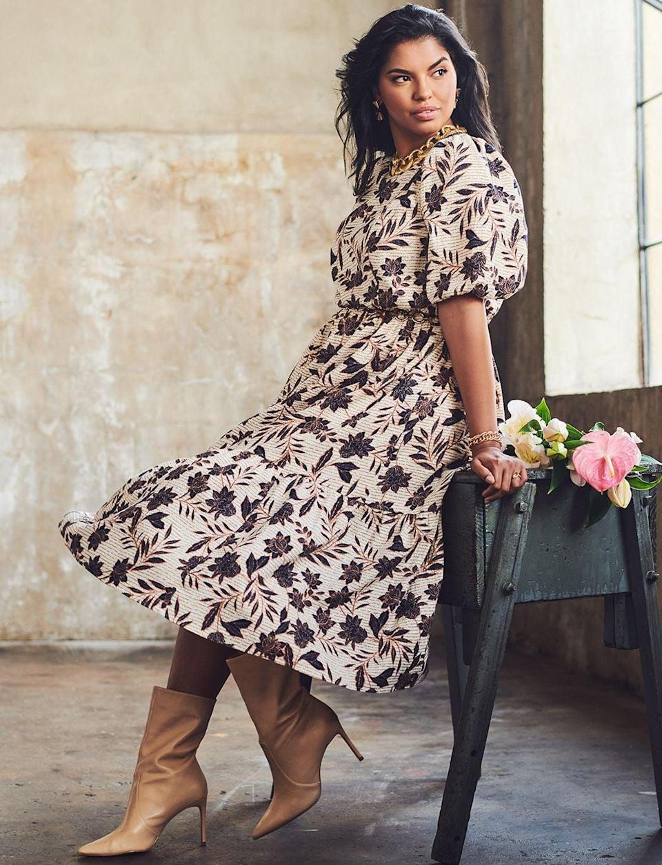 <p>The print on this <span>Eloquii Midi Dress</span> ($130) is beautiful. This style goes great with boots.</p>