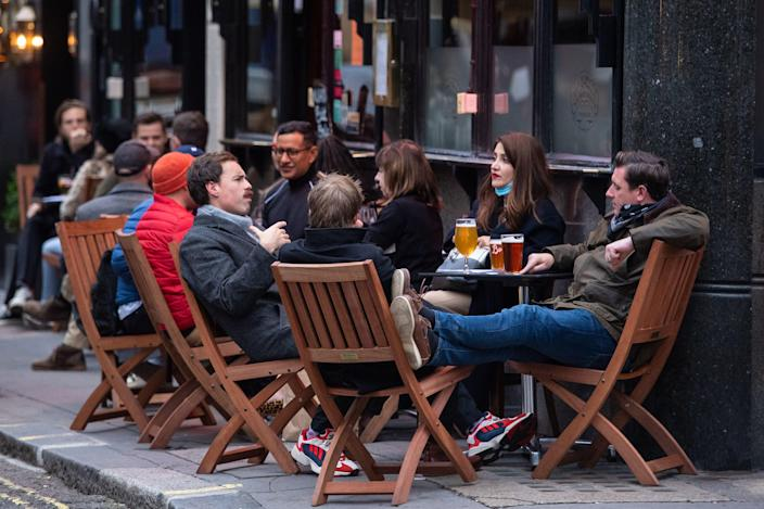 <p>Drinkers will be allowed indoors from Monday, as restrictions ease further</p> (PA)