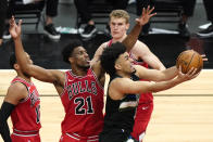Milwaukee Bucks forward Jordan Nwora, right, drives to the basket past Chicago Bulls forward Thaddeus Young (21) during the first half of an NBA basketball game in Chicago, Sunday, May 16, 2021. (AP Photo/Nam Y. Huh)