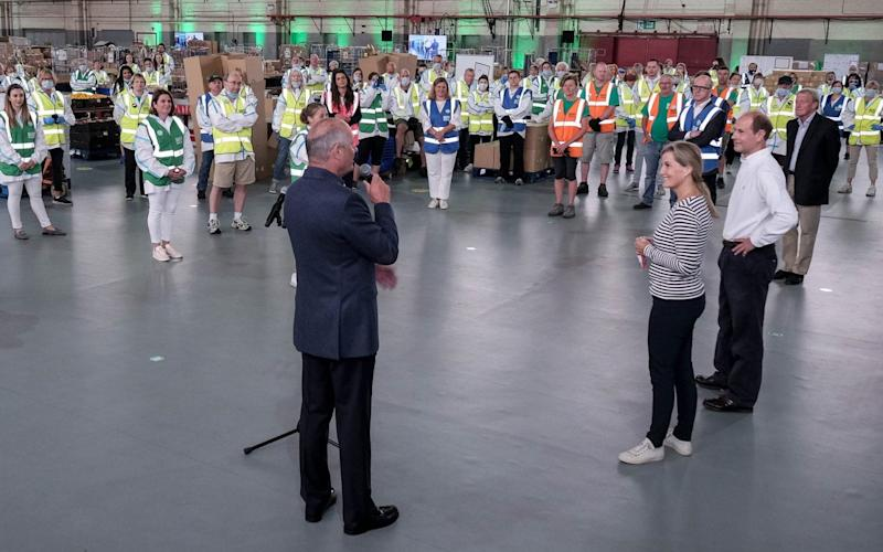 Ron Dennis speaking to Prince Edward, Earl of Wessex and Sophie, Countess of Wessex and volunteers at SaluteTheNHS operations centre in Bicester, July 2 2020 - Adrian Wroth Photography